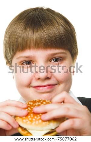 fun young fat schoolboy eating big hamburger - stock photo
