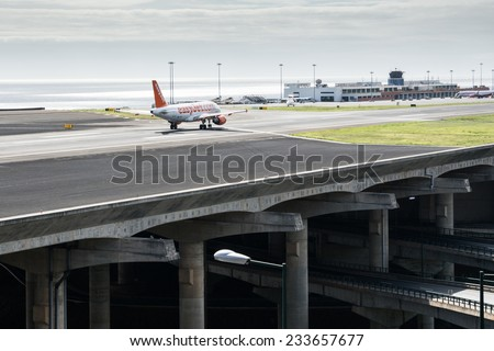 FUNCHAL, PORTUGAL - Nov 13: Passenger plane from airline easyJet prepares for take off from Funchal Airport on November 13, 2014 at Madeira, Portugal - stock photo