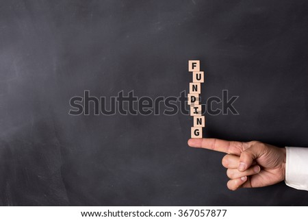 FUNDING word with in form of stacked blocks - stock photo