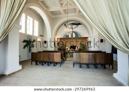 Funeral hall decorated with flowers, prepared for burial ceremony - stock photo