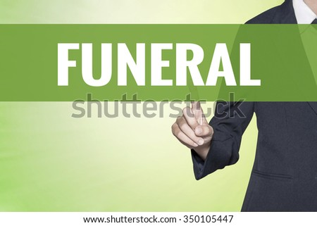 Funeral word on vintage green virtual screen touching by business woman - stock photo