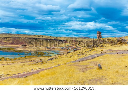 Funerary towers and ruins in Sillustani, Peru,South America- Inca prehistoric ruins near Puno,Titicaca lake area. - stock photo