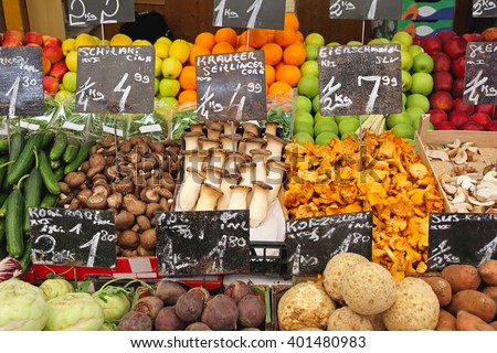 Fungy Mushrooms and Produce in Crates at Farmers Market - stock photo