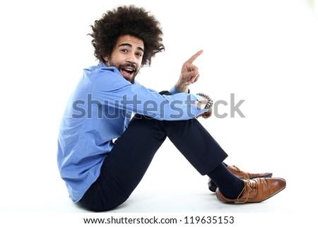 Funky Afro man sitting - stock photo