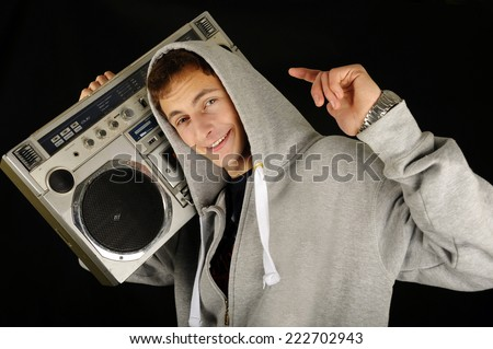 Funky man listening to music on the radio - isolated over a white background, Happy black man with a radio enjoying the music - stock photo