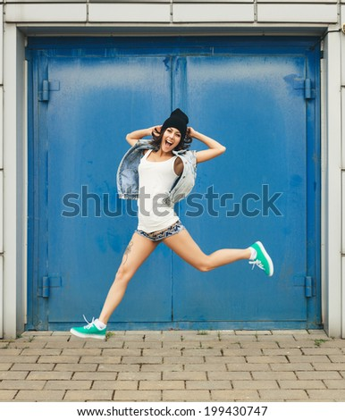 Funky teenage girl having fun. Lifestyle portrait - stock photo