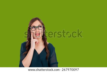 Funni cool girl thinking something on a green background - stock photo
