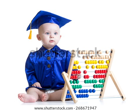 Funny academician kid toddler boy with counter toy - stock photo