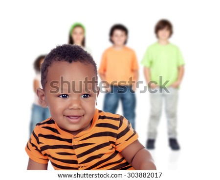 Funny afroamerican baby with other children unfocused of background - stock photo