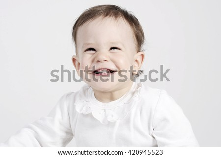 funny and happy baby portrait with clear background - stock photo