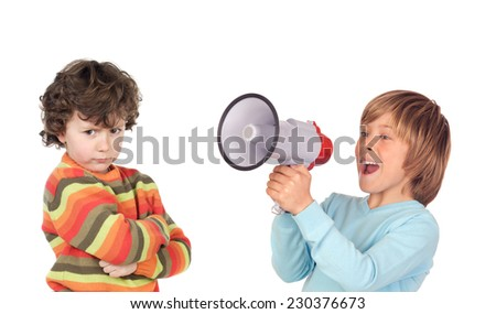 Funny angry child because his friend is screaming with a megaphone  - stock photo