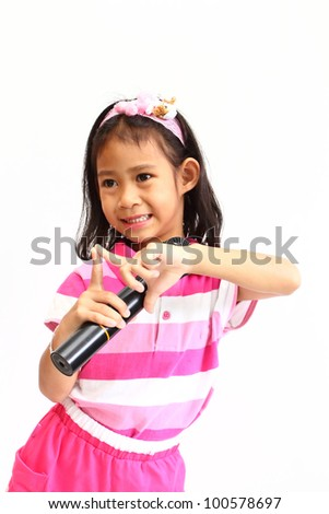 Funny asia little girl singing with a microphone isolated over white background - stock photo