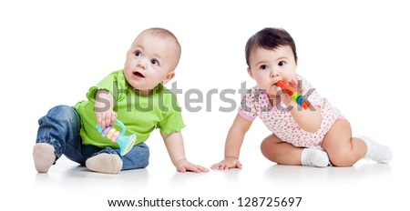 Funny babies girls  with musical toys isolated on white - stock photo