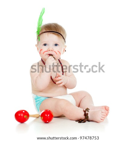 funny baby  as indian  boy with maracas and feather - stock photo