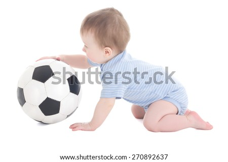 funny baby boy toddler playing with soccer ball isolated on white background - stock photo
