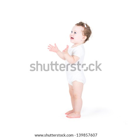 Funny baby girl clapping hands, on white background - stock photo