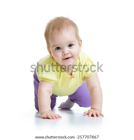 funny baby girl goes down on all fours - stock photo