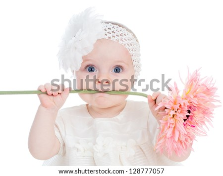 funny baby girl with flower - stock photo