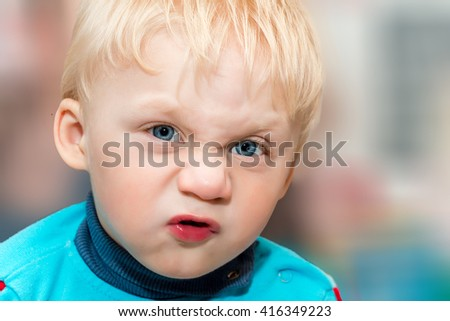 Funny baby grimaces. Closeup. Selective focus on the eye. - stock photo
