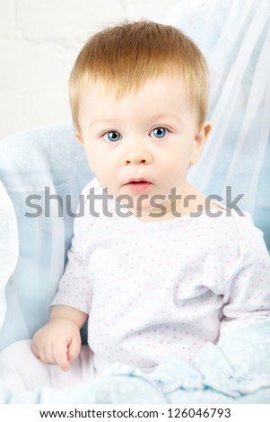 funny baby in cradle, happy and smiling - stock photo