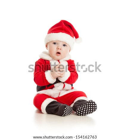 funny baby in Santa Claus clothes - stock photo