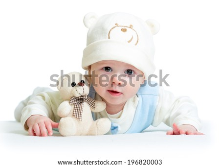 funny baby weared hat with plush toy - stock photo