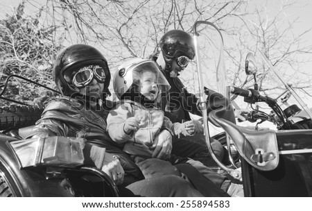 Funny Baby with grandparents at custom sidecar bike - stock photo