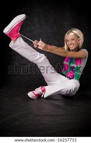 funny blonde young woman in studio - stock photo