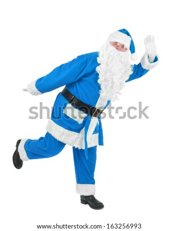 Funny blue santa waves hand over white background - stock photo