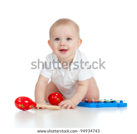 funny boy baby  with musical toys. - stock photo