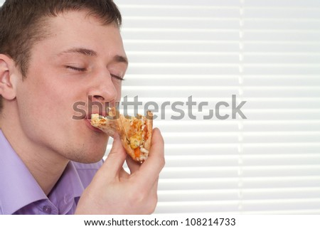 Funny boy is going to eat a slice of pizza - stock photo
