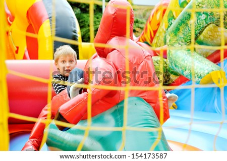 funny boy playing on   trampoline   - stock photo