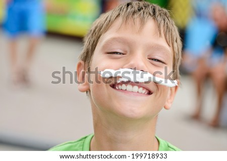 funny boy with cotton candy mustache - stock photo