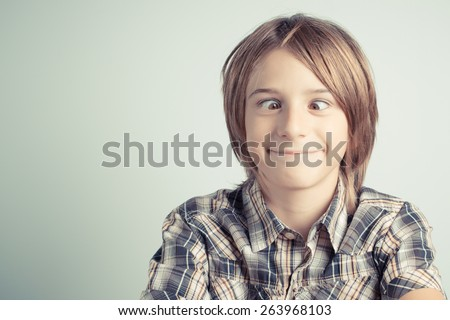funny boy with cross-eyed - vintage style photo - stock photo