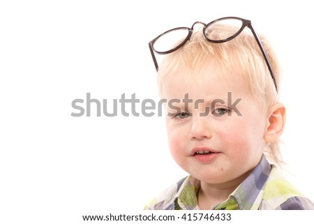 Funny boy with glasses, close up portrait, isolated on white - stock photo