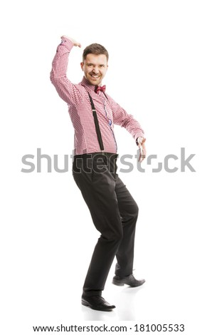 Funny business man is posing in studio with bow tie and braces - stock photo