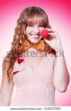 Funny Business Woman Clowning Around When Putting A Big Red Clown Nose On In A Depiction Of Funny Business - stock photo