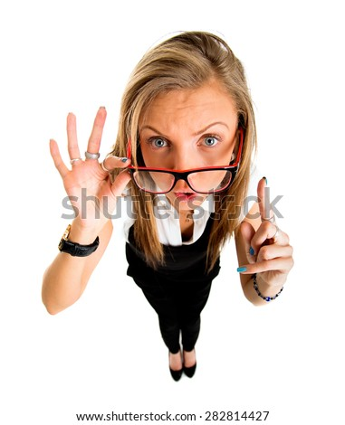 Funny businessl girl pointing up, fish eye lens portrait. - stock photo