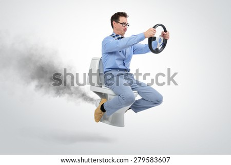 Funny businessman flying on the toilet. Concept of movement - stock photo