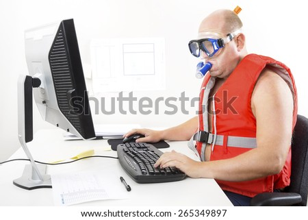 Funny businessman in diving mask and snorkel - stock photo