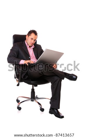 Funny businessman sitting and working on laptop. Isolated on white background - stock photo