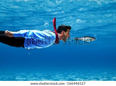 Funny businessman swimming underwater - stock photo