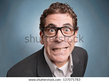 Funny businessman with crazy expression - stock photo