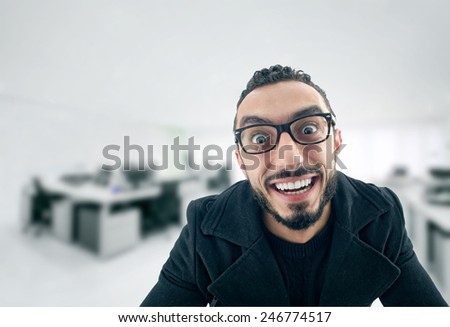 Funny Businessman with crazy expression, Lazy Businessman making funny expressions at work  - stock photo