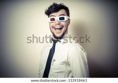 funny businessman with 3d eyewear on gray background - stock photo