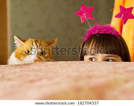 Funny caucasian girl look out from the bed - stock photo