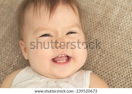 funny cheerful caucasian baby girl smiling portrait - stock photo