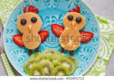 Funny chickens pancakes with berries for kids breakfast - stock photo