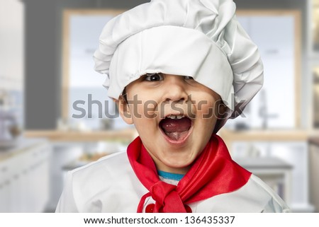funny child dressed as a cook - stock photo