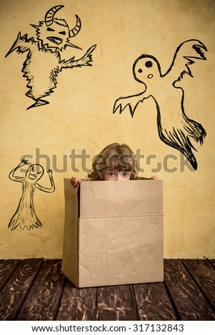 Funny child dressed witch costume. Halloween holidays concept - stock photo